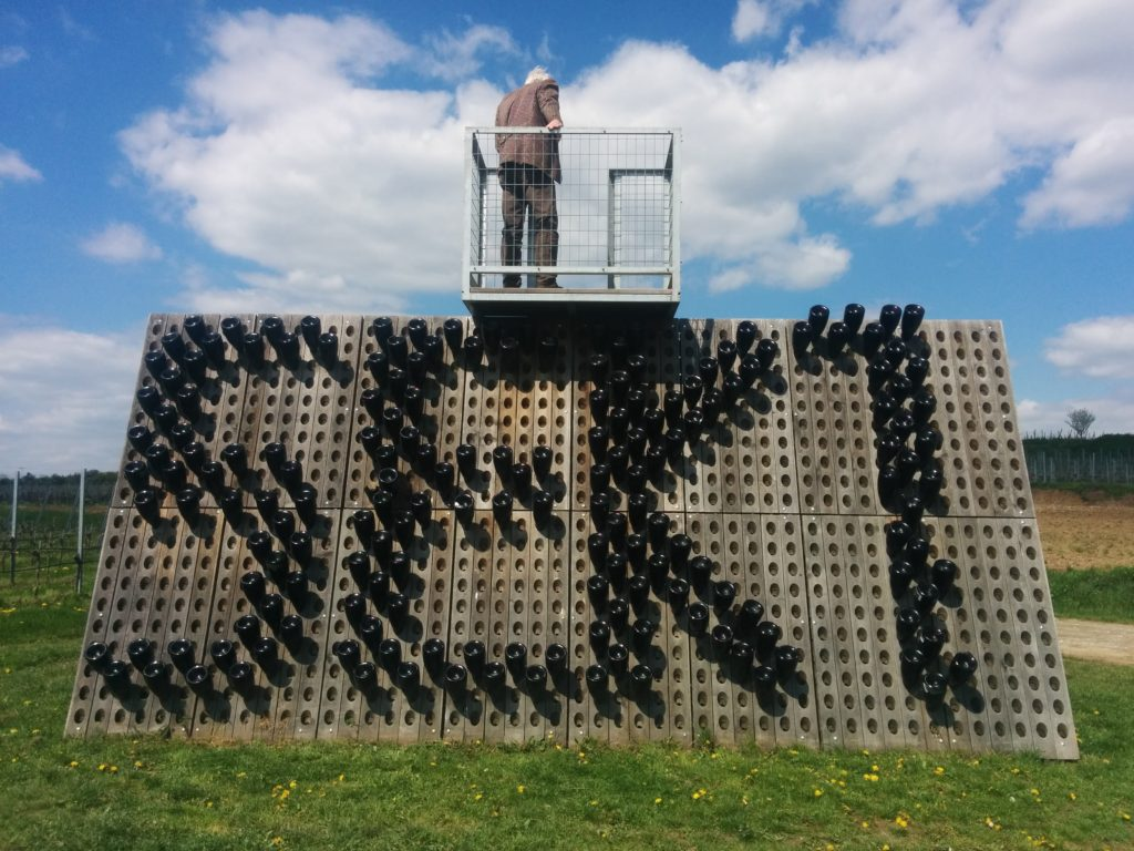 That's Karl Steininger on the observation platform...below him are sekt bottles in riddling racks cleverly forming the sign